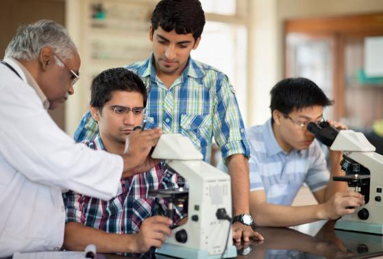 Indian professor and students in a science lab