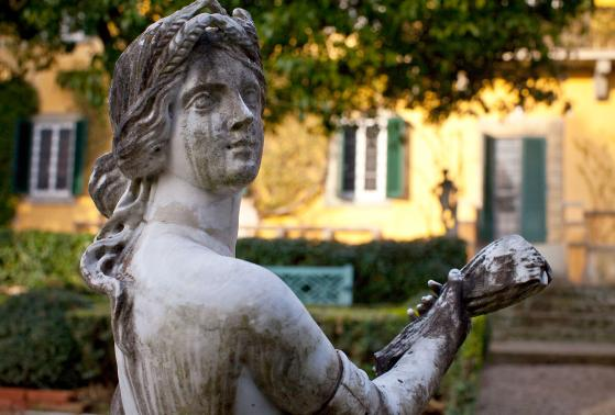 A statue in the gardens outside of Villa i Tatti near Florence, Italy