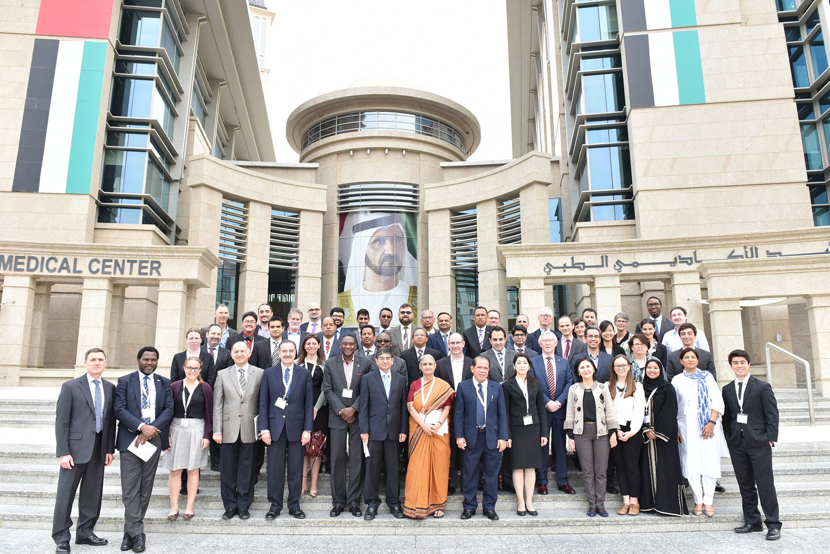 Attendees of the Global Surgery Symposium pose outside the Maktoum Academic Medical Center, home to the HMS Center for Global Health Delivery—Dubai.