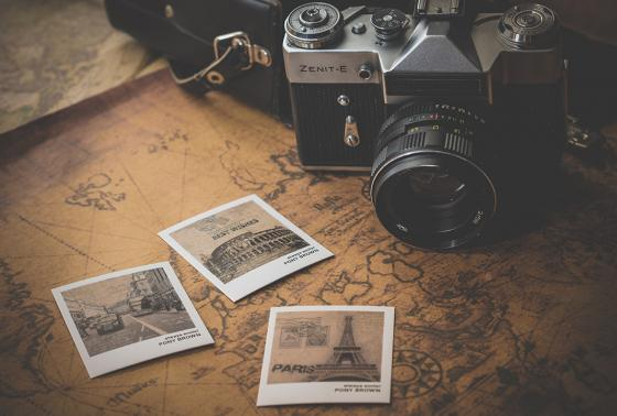 An old-fashioned camera, map, and photos